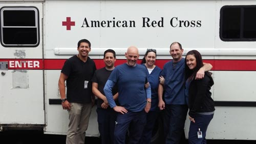 employees outside American Red Cross blood drive van